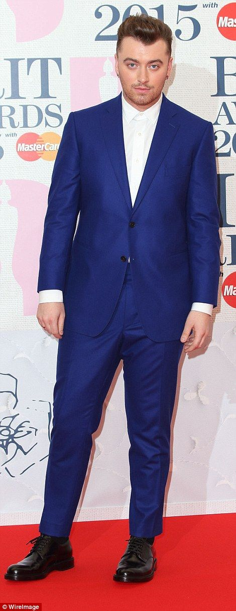 Top nominee Sam Smith is dapper in dark blue as he arrives at the BRITs 2015