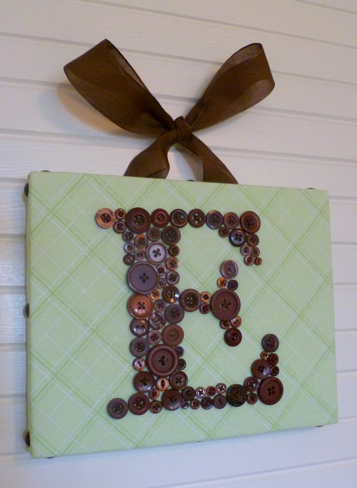 "Baby Nursery Button Monogram on 8""x10"" Canvas -- Chocolate Brown on Spring Green -- Personalized Nursery Letter Art. $55.00, via Etsy."