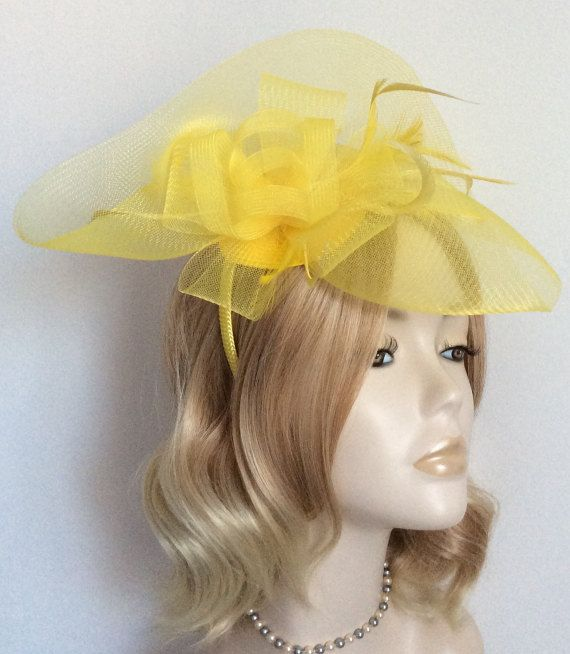 CANARY YELLOW FASCINATOR Made of crin feathers all mounted