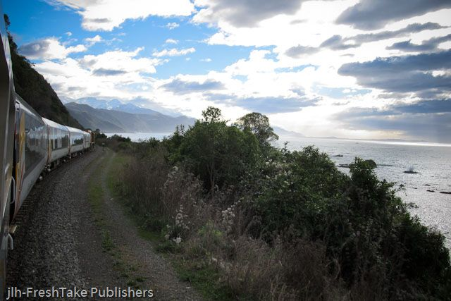 This photo is taken from the Coastal Pacific train as it travels along the coast from Christchurch to Picton in the South Island of New Zealand. This photo shows the sea, the sky and the mountains all in one shot. In New Zealand your natural environment changes quickly and this photo illustrates it so well.