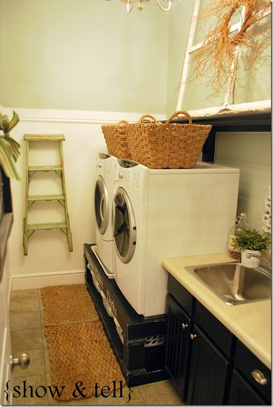 Dream laundry room...I think I would like doing my laundry more...or at least that's what I am telling myself...I love the platform she created. There are baskets underneath to sort.