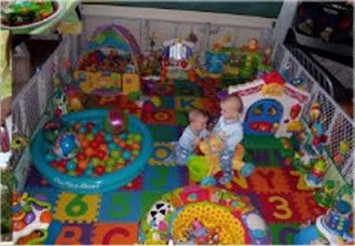ball pit in our baby play area. Do for my kids and bunch of toys and add tiles and bunch things keep safe for the kids play room ,I'm going to make play room look a little like this but instead a fence I can close the playroom door .