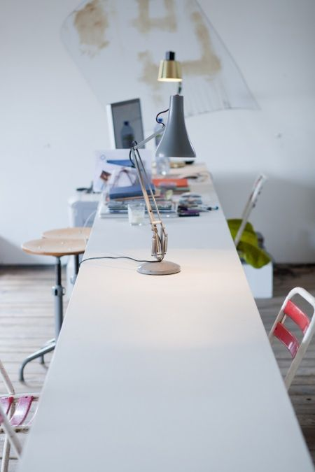 Long And Narrow Work Table For A Graphic Designer. White And Airy Room  Inspires A Clear Mind And Creativity.