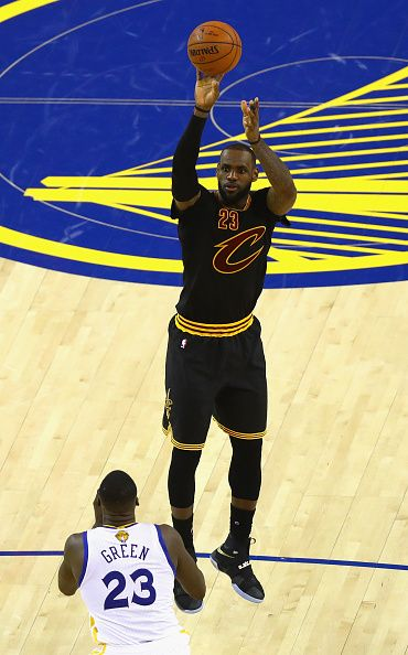 LeBron James of the Cleveland Cavaliers shoots the ball against Draymond Green of the Golden State Warriors in Game 7 of the 2016 NBA Finals at...