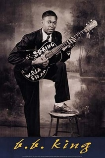 Young B.B. King~Riley B. King (born September 16, 1925), known by the stage name B.B. King, is an American blues musician, singer, songwriter, and guitarist.