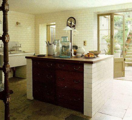 metro tiles - White English kitchen with metro tiled walls - World of Interiors via Atticmag
