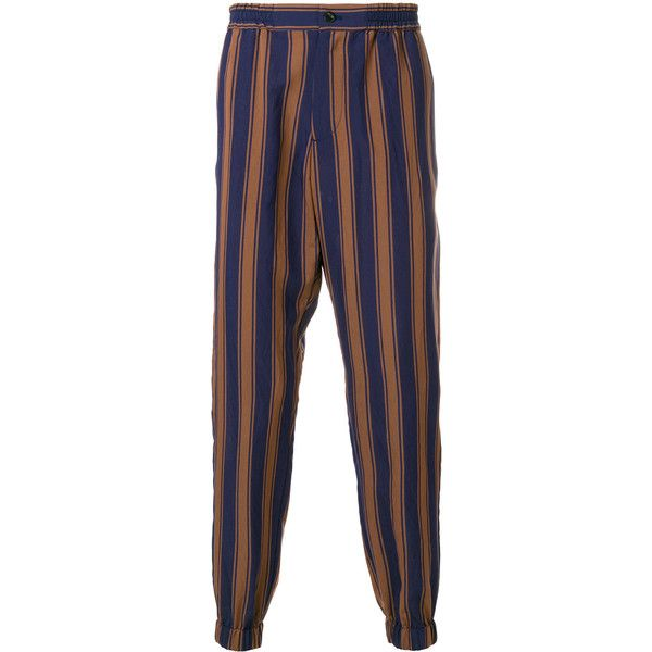 Etro striped tapered trousers ($388) ❤ liked on Polyvore featuring men's fashion, men's clothing, men's pants, men's casual pants, blue, men's relaxed fit pants, mens boho pants, mens elastic waistband pants, mens elastic cuff pants and mens elastic waist pants