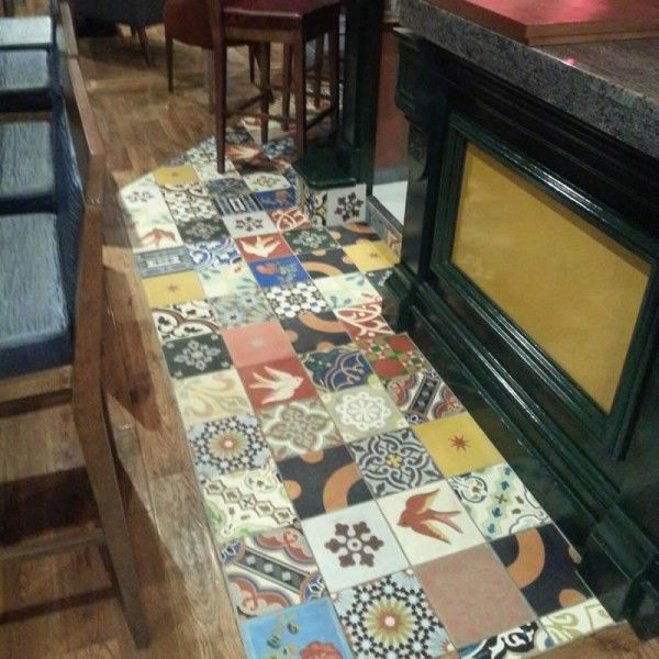 Patterned Moroccan Encaustic Tiles inlaid into timber flooring. This photo was taken at The Cleaboy Pub in Waterford, Ireland. The tiles used are one of our bestsellers.