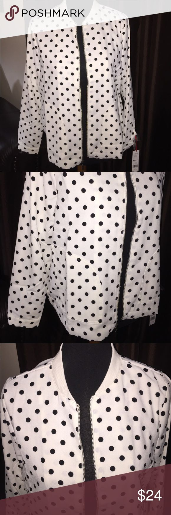 NWT Elle Polka Dot Zip Up Jacket - Size Medium This jacket is long sleeved. It zips up. The Jacket is white and the dots are black. Two pockets on the side. Light Weight. Collar is cotton. It is lined. 100% polyester. All items have been pre owned, lightly used, NWOT or NWT. They come from a smoke free home. I can not promise items are in perfect condition but they have been cared for extremely well. If there are issues please read the description and look at the images posted. If you have…