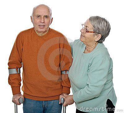 Happy senior woman helping her disabled husband to walk. Isolated against white background.