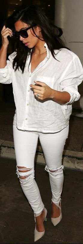 Who made Kim Kardashian's white ripped jeans, pumps, and black sunglasses?
