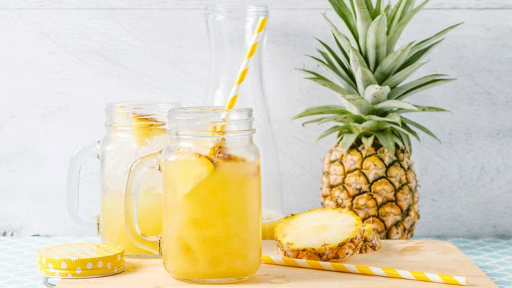 Kiss the dog days goodbye with this Tropical Pineapple Moonshine that immediately whisks you away to a white sand beach with your toes in the sand.