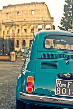 An old school blue Fiat 500 parked in front of the Colosseum in Rome. Yup. That'll about do it.