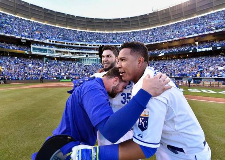 Kansas City Royals first baseman Eric Hosmer, Kansas City Royals third baseman Mike Moustakas and Kansas City Royals catcher Salvador Perez hugged after they defeated the Orioles at Wednesday's ALCS playoff baseball game on October 15, 2014 at Kauffman Stadium in Kansas City, MO The Royals defeated the Orioles 2-1 to win the ALCS.