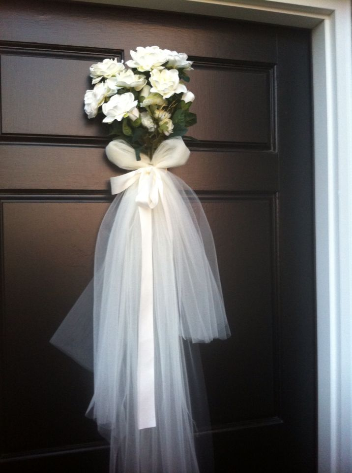 My idea, but made by mom for bridal shower. Door wedding veil made with white tool, ribbon, and flowers.