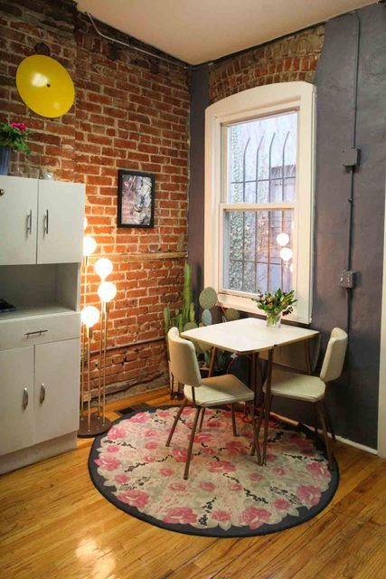 what an adorable little dining room and the exposed brick, sigh.
