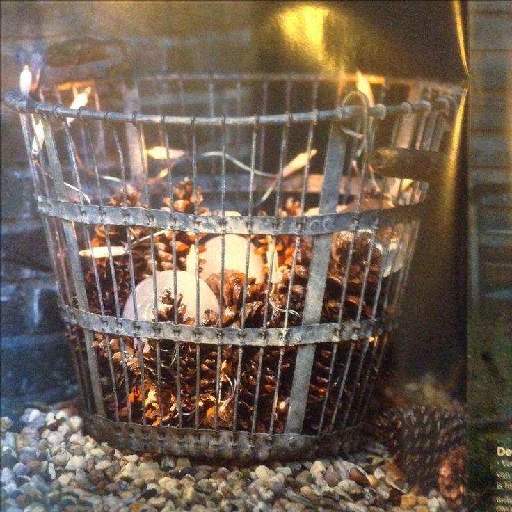 Metal basket with pine cones. Could spray paint pine cones gold and silver too.