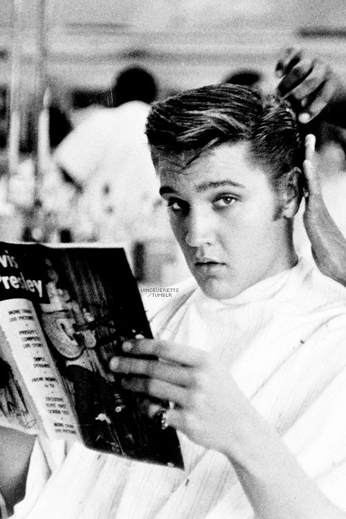 Elvis getting a haircut at Jim's Barber Shop in Memphis, July 1956. Photo by Lloyd Shearer.
