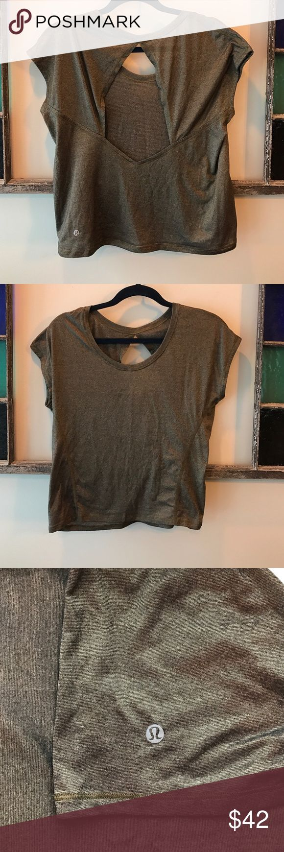Lululemon shirt Gorgeous gold metallic lululemon open back shirt, perfect over a cute strappy lulu bra, super light weight and comfy, could just as easily wear to the gym as out for the night lululemon athletica Tops