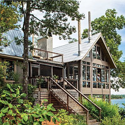 """Alabama lake house called """"Seven Sticks""""... named for 7 tapered timber poles that support it and are placed randomly throughout the structure"""