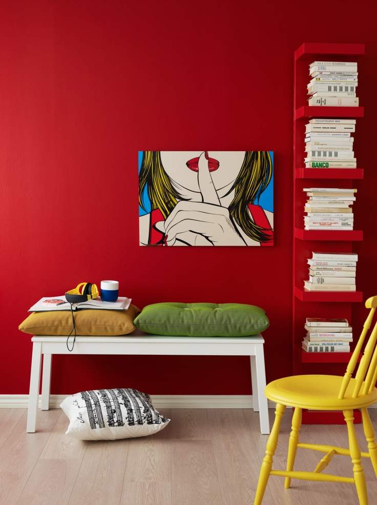 red wall. And I love that white cushion!