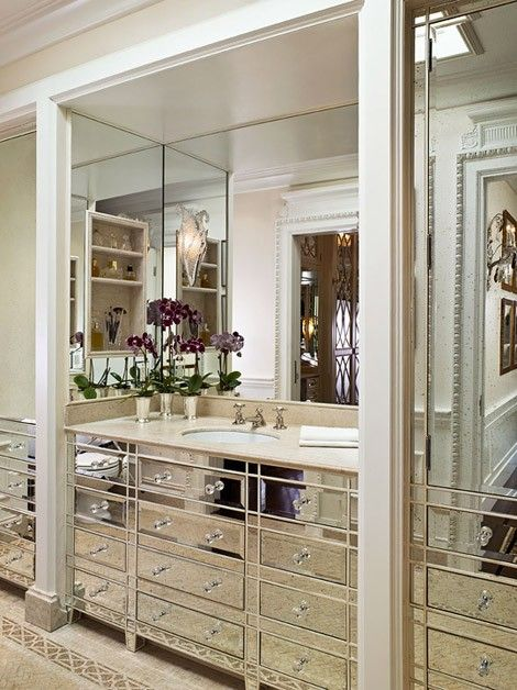 Photo Gallery For Website Beaux Arts Mansion Chic mirrored bathroom design with mirrored bathroom vanity washstand with glass knobs marble counter top and polished nickel faucet