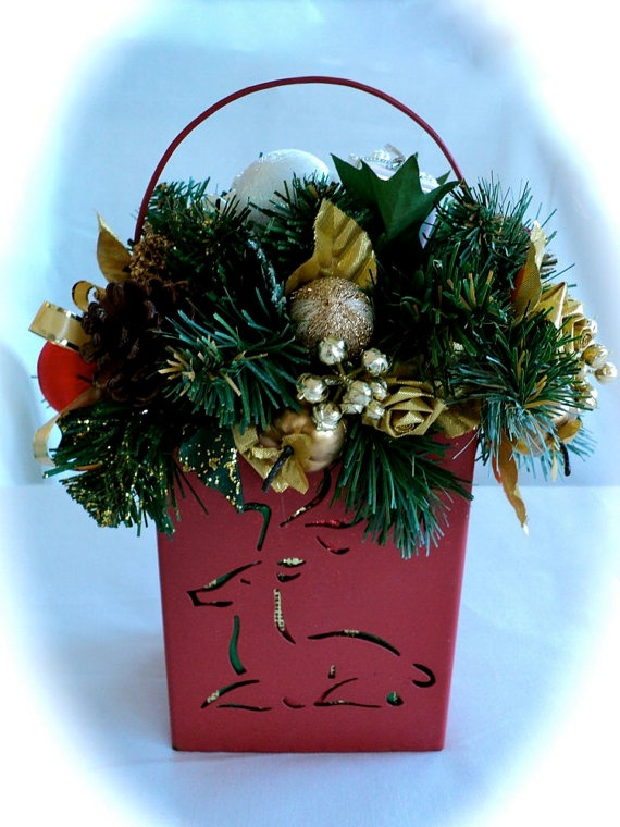 Christmas floral arrangement in reindeer container