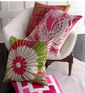Green and pink pillows for apartment above tea cottage