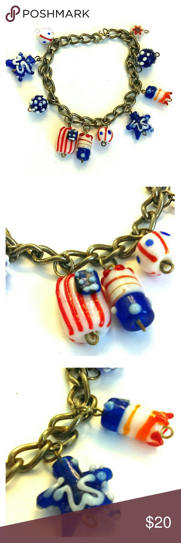 """USA Patriotic hand-crafted glass charm bracelet Red, white, and blue around your wrist in a series of ten  handcrafted glass beads in patriotic designs. Perfect for Memorial Day, Flag Day, Fourth of July, and Labor Day, as well as everyday use.   8"""" on antiqued-silver chain with lobster-claw clasp.   Bundle for additional savings. Jewelry Bracelets"""