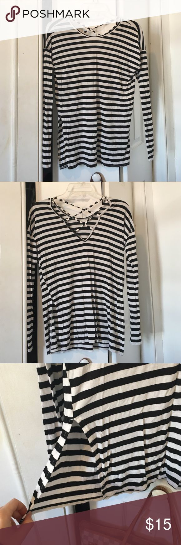 Hollister Black and White strappy top Has a cute strappy back and slits on sides! Sexy fit. Only worn a couple times. Hollister Tops