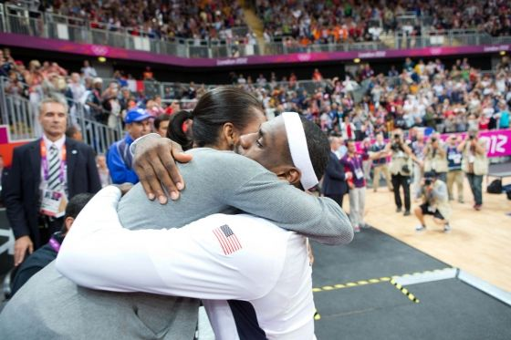 First Lady Michelle Obama hugs LeBron James following the USA vs. France men's basketball game at Olympic Park during the 2012 Olympic Games in London, England, July 29, 2012. (Official White House Photo by Sonya N. Hebert)