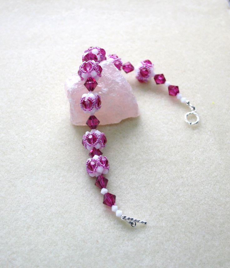 Gorgeous Swarovski white alabaster and fushia crystal bracelet.  www.facebook.com/Supposejewellery