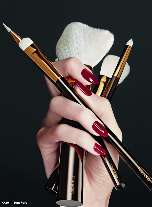 Tom Ford Makeup brushes. Interesting use of hand.