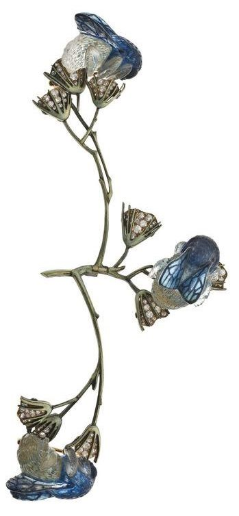 An Art Nouveau 'Bumblebees on Flowers' corsage brooch, by René Lalique, France , circa 1905/1906, left branch articulated, composed of gold, translucent enamel, moulded glass and brilliant-cut diamonds. #ArtNouveau #Lalique #corsage #brooch