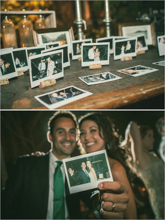 polaroid cameras at wedding reception = instant fun *love the cork screws to hold pics up.