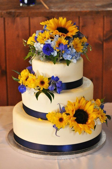 Navy blue and yellow wedding - sunflowers - wedding cake - Would prefer in square tiers, cobalt blue, and fewer flowers.