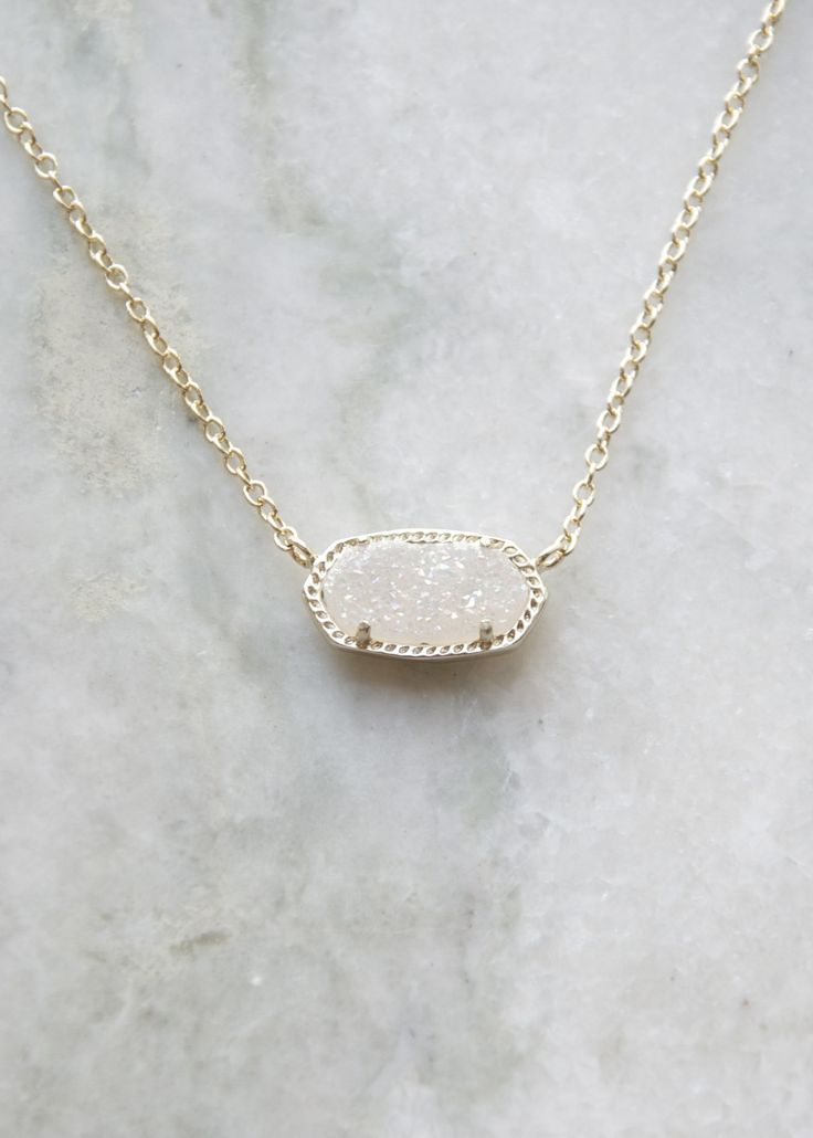 "Shown in gold tone/iridescent druzy. Size: 0.63""L x 0.38""W stationary pendant, 15"" chain with 2"" extender. 14K Gold Plated Over Brass. Lobster claw closure. Please note: Due to the one-of-a-kind natur"