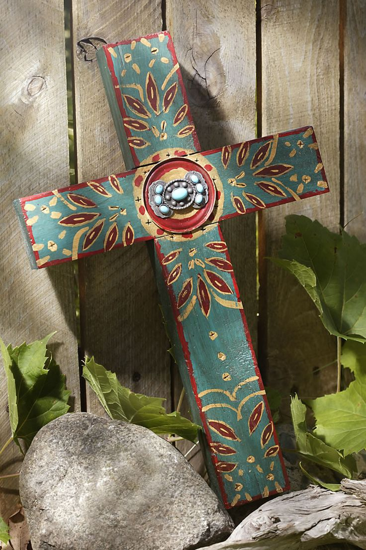 This western-style cross, adorned with the concho medallion in the center and hand-painted detail, will add beauty and charm to your western decor. - Made from reclaimed wormwood - Hand-Painted: Teal