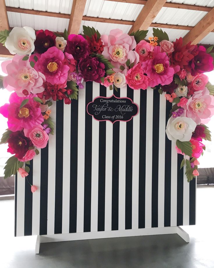 How perfect is this black and white stripped and flowery backdrop for a photo wall?! If you are throwing a party or event, everyone loves being able to take pictures!