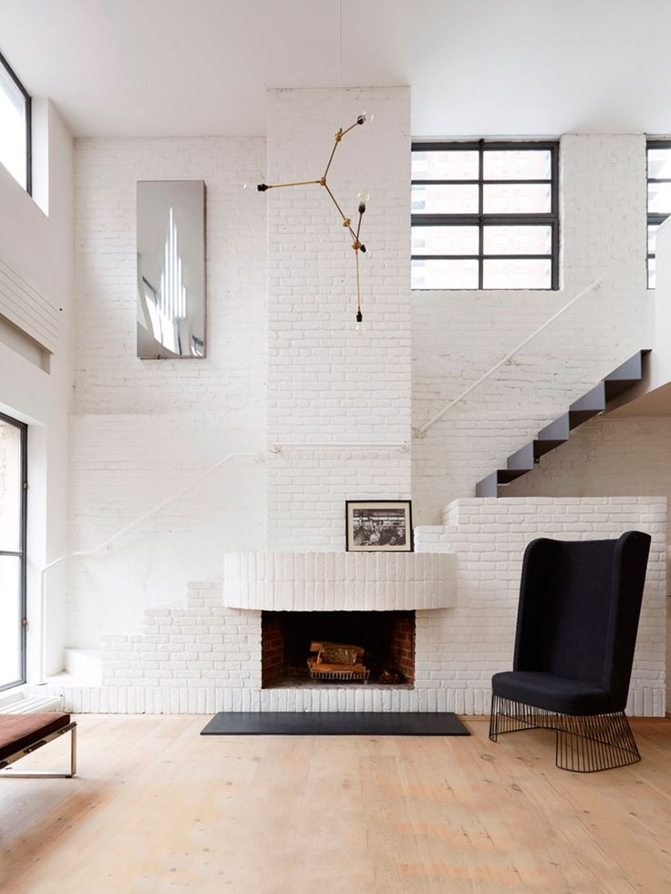 Tall White Brick Fireplace