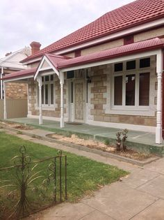 Bullnose Verandah with Colorbond Roofing - single sheets of glass in casements - it looks okay!  That is what I want......