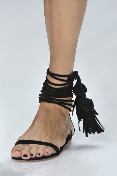 The ugliest shoes i have ever seen. Looks like a curtain tie got wrapped around her ankle...