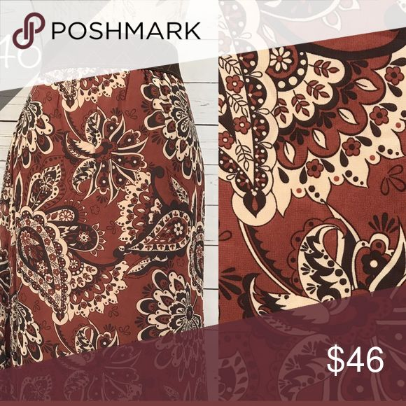 Lularoe Lola bnwt Beautiful paisley Lularoe Lola, size large. Brand new with tags still attached. Deep reddish brown color with black. LuLaRoe Skirts A-Line or Full
