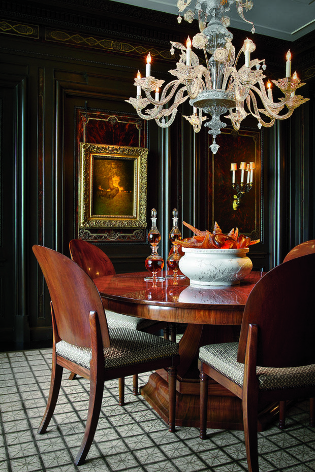 The Luxurious Dining Room With Venetian Glass Chandelier.