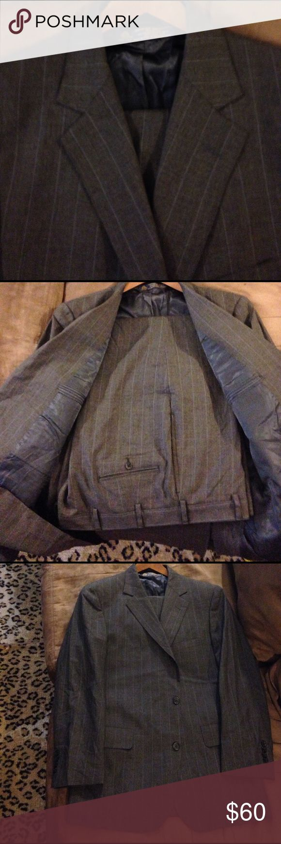 Brooks Brothers Grey w/ Blue Pinstripe Suit 41R Brooks Brothers Grey with Blue Pinstripe Suit size 41R Regular, 3 Button/ Roll 2 Button and Single vented! Pants are a size 36x32, Flat Front and Plain Bottom! Great condition! Please make offers and bundle! Brooks Brothers Suits & Blazers Suits