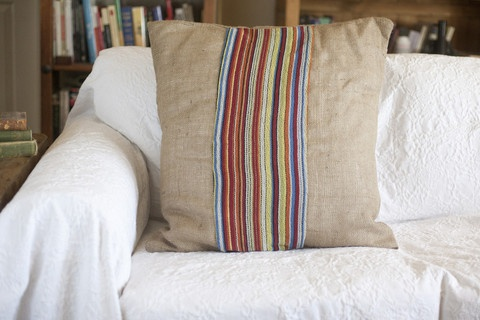 Large soft burlap pillow with super-soft colorful linen strip. An eye-catching addition to any couch! ... One of ours.