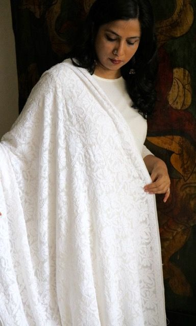 Hand-embroidered off-white Chikankari dupatta in pure georgette, with floral shadow work and 'muri' embroidery all over. This is an exclusive handmade piece that takes an artisan in Lucknow nearly 6 months to complete. Available at www.facebook.com/omnah