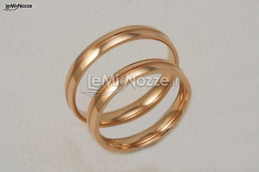 http://www.lemienozze.it/operatori-matrimonio/gioielli/biffi_gioielli/media/foto/19  Fedi nuziali rosa