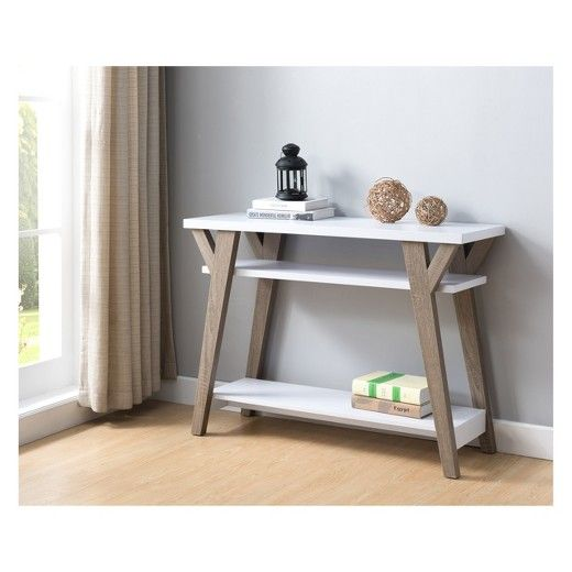The ioHOMES Ennis Transitional Console Table is the perfect table to place near the entryway. Never forget the small essentials when heading out the door ever again! With a stylish light oak and white color scheme and accented wooden legs, this table will help exude the hominess of your abode. Furnish your doorway with the charming ioHOMES Ennis Transitional Console Table and organize your outdoor essentials!