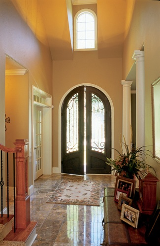 Frank betz homes photo gallery brick stone shutters arch topped windows this plan offers for Frank betz house plans with interior photos